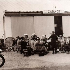 Outside Adams' Garage being conducted by Dougie Judd