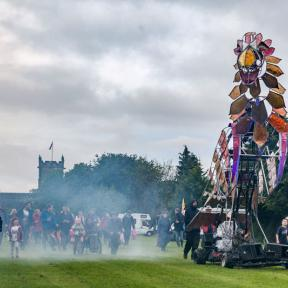The firebird came to the festival and joined the procession of women's chorus, children from school with fire and water, scouts with willow chickens and festival goers to light the beacon