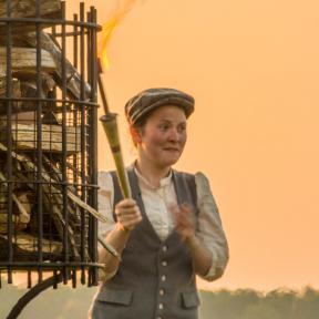 Our street performers light the beacon as the Wheelwright and his apprentice